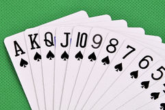 Set of play cards poker casino on a green background Royalty Free Stock Photo