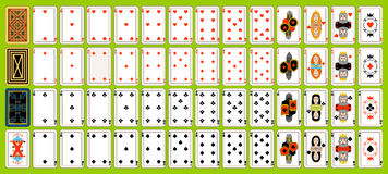 Set of playing cards. Complete set of playing cards. Playing cards are located on a green background Stock Photos