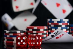 Set for playing for money, two aces and dice on a black background, flying cards stock images