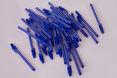 Blue plastic pens isolated on white stock photography