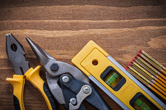 Set of pliers sharp steel cutter construction level wooden meter Royalty Free Stock Photo