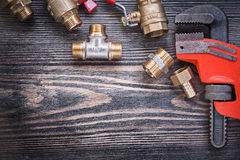 Set of plumbers tools on wooden board plumbing concept Stock Photos