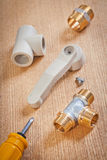 Set of plumbing items on wooden boards Stock Photos