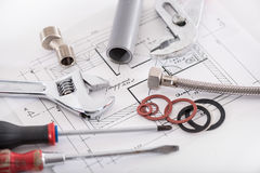 Set of plumbing materials. On a plan Royalty Free Stock Images