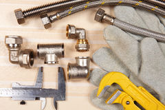 Set of plumbing and tools Stock Photo