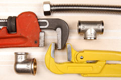 Set of plumbing and tools Royalty Free Stock Photos