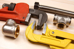 Set of plumbing and tools Stock Photos