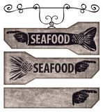 Set of pointers with human hand and fish tail. Set of vector pointers and street signs for a seafood restaurant or seafood shop with a human hand and a fish tail Royalty Free Stock Photography
