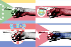 Set of pointing finger in national flags Royalty Free Stock Photos