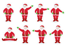 Set of pointing Santa Clauses Stock Photography