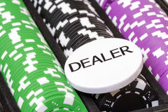 Set of poker chips and dealer button Stock Images
