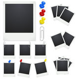 Set Polaroid photo frames with clips and thumbtacks on white background. Stock Images