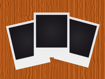 Set of polaroid on wood texture Royalty Free Stock Photo
