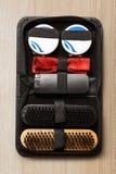 Set of polish cream and shoe brushes Stock Photos
