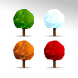 Set of 4 polygonal trees for all seasons Spring Summer Autumn Wi Stock Photography