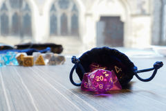 A set of polyhedral dice with a draw string bag Stock Photos