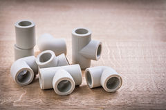 Set Of Polypropylene Pipe Fittings On Wooden Board Stock Image