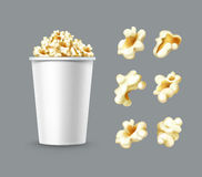 Set of popcorn. Vector set of different popcorn kernels with white bucket close up side view isolated on gray background Royalty Free Stock Photo