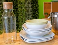 Set of Porcelain Dishes, Bowls Plates and Glass Bottle Royalty Free Stock Image