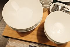 Set of Porcelain Plates, Bowls and Silverware Royalty Free Stock Photo
