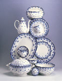 Set of porcelain plates and dishes Stock Images