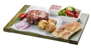Set of pork steak, vegetable salad, potatoes and sauce. Chalagach stock image