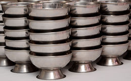 A SET OF POTS, STAINLESS STEEL Royalty Free Stock Photo