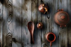 Set of pottery on dark wooden table in retro style. Top view. Stock Image