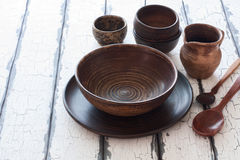 Set of pottery over natural wood background Stock Images