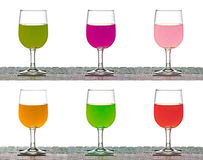 Set of pouring juice into glasses  on white background Royalty Free Stock Photos