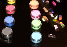 Set of powder cosmetic and fake nails. On a mirror table (shallow dof royalty free stock photos