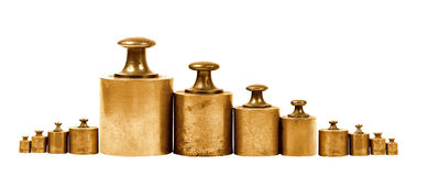 Set of precision weights for a balance scale Stock Photos