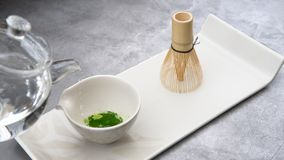 Set for preparing matcha tea, green leaf stock image