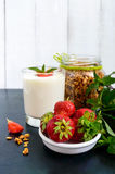 A set of a product for a delicious healthy breakfast: granola, yogurt Stock Photo