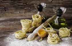 A set of products for cooking pasta with wheat flour, a selective focus Royalty Free Stock Photography