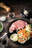 Set of products for cooking pork steak meat veal scraps beef tenderloin. Set of products ingredients for cooking pork steak meat fork veal scraps beef with royalty free stock images