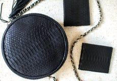 Set produkty które zrobili pyton skóra Czarna luksusowa torba i purset, portfel Kiesa dla mężczyzny, portfel dla kobiety Moda obraz stock