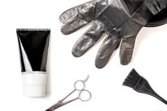 Set of professional black hairdresser tools for coloring hair - bleach brush, bowl, scissors, gloves and tube of coloring stuff,. Composition on white royalty free stock photography