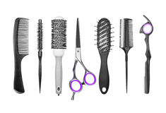 Set of professional hair brushes and scissors. Isolated on the white Stock Image