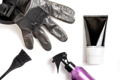 Set of professional hairdresser tools for coloring hair - bleach brush, bowl, spray, gloves and tube of coloring stuff,. Composition on white background stock images