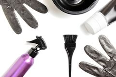 Set of professional hairdresser tools for coloring hair - bleach brush, bowl, spray, gloves and tube of coloring stuff,. Composition on white background stock image