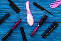 Set of professional hairdresser tools with combs blue wooden background top view stock photos