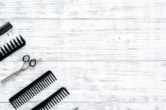 Set of professional hairdresser tools with combs gray wooden background top view mock-up stock photo