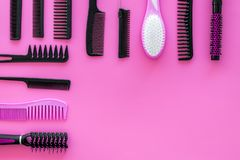 Set of professional hairdresser tools with combs pink background top view mockup royalty free stock photography
