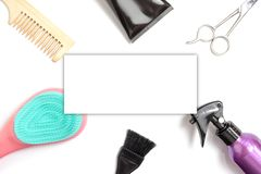 Set of professional hairdresser tools equipment on white background - scissors, comb, brush and spray - hair stylist concept with stock photos