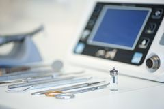 Set of professional instruments in dentist`s office royalty free stock image