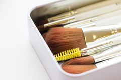 Set of professional make up brushes. Make Up Beauty Concept. Set of make up brushes for lipstick, eyeshadows, foundation, powder, eyeliner and blusher in a metal Stock Photography