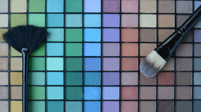 Set of professional make-up brushes with the Pallette of shadows Stock Photos