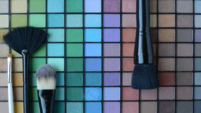 Set of professional make-up brushes with the Pallette of shadows Stock Images