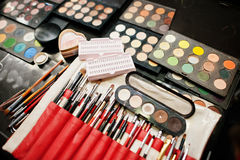 Set of professional makeup brush and colorful eye shadows palett Royalty Free Stock Photography